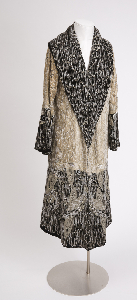 Evening coat in white velvet with applied black beads, white beads, and silver metallic embroidery