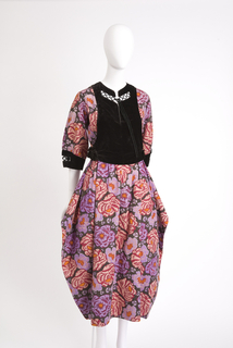 Day dress in boldly floral printed cotton with purple, gold and blood-red blossoms on black ground