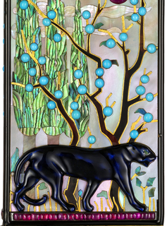 Vanity case depicting a dark blue enameled panther on a row of rubies, against a mother-of-pearl garden landscape with a ruby sun, and a tree of turquoise blossoms, borders and reverse decorated with raised onyx bars alternating mother-of-pearl inlay accented with diamonds, the push piece designed as a gem-set songbird; interior with fitted mirror, perfume vial, lipstick case and covered compartment for powder