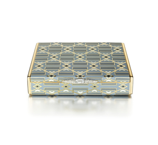 rectangular with slightly rounded edges, enamelled in blue-grey and grey, geometric patterns with black enamelled and  gold line lozenge form decoration, with diamond-set platinum thumbpiece; the interior fitted with mirror,powder compartment, and lipstick holder