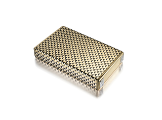 Vanity case with a hinged lid decorated in black and white enamel with an all-over chevron and dot stylized lattice motif, the sides accented with four diamond-set squares concealing the push-button opening mechanism; with a fitted mirror and compartments for powder, rouge and lipstick