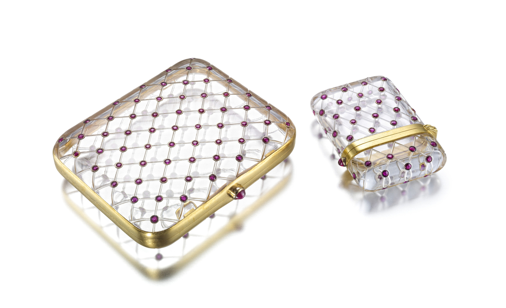 Rectangular cigarette case with rounded corners and matching box composed of carved rock crystal of lattice design studded with round rubies, both with cabochon ruby thumbpiece
