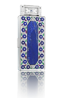 Vanity case with central lapis lazuli panel with diamond triangles surrounded by geometric stylized flowers and leaves on a vine, with a diamond-set button clasp; interior with fitted mirror, powder compartment, and ivory writing tablet, a hidden spring lock releases a rectangular watch on one side and a pencil on the other