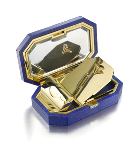 Octagonal vanity case with trapeze- and baguette-cut diamonds arranged in a geometric motif, the button clasp set with two baguette-cut diamonds; interior with fitted mirror, lipstick holder, and powder compartment; mounted in gold and platinum