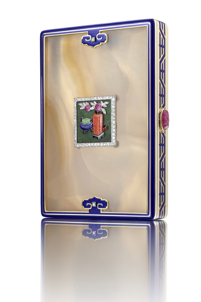 Cigarette case composed of agate panels on front and reverse within blue enamel trim, front decorated with a square plaque showing a tablescape