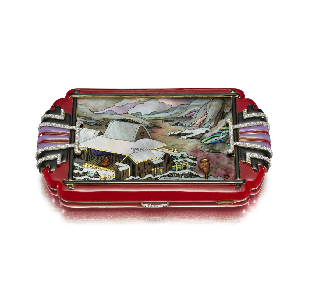 Vanity case in red enamel, the central panel with a hardstone and tinted mother-of-pearl mosaic, the panel is outlined in calligraphy-like stylized black enamel lines that overlap at the corners, the edges of the case are decorated in purple, red, and black enamel accented with round diamonds, with a diamond-set button clasp; interior with fitted mirror, two compartments, and lipstick holder