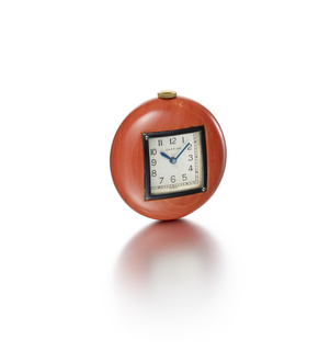 of cushion form from a single piece of coral, set with a square face, white enamelled dial with black Arabic numerals and gold bezel.