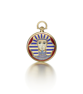 circular dial with Roman and Arabic numerals on inner chapter rings, contained within a gold case decorated on the cover in polychrome enamel with the mask of Tutankhamun against a ground of red guilloché enamel; mounted in 18-karat gold