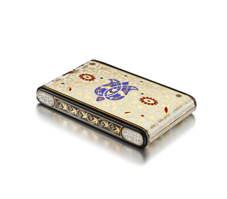 of rectangular shape with rounded ends, hinged on the short side, with flowers and foliage in gold on a cream enamel ground, with blue central floral motif and red highlights,  the sides in black enamel with continuous vine pattern, the interior with bevelled mirror, powder compartment, and lipstick holder