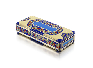 Rectangular box with hinged lid decorated in Persian style with floral and geometric motifs, with push button clasp on a hidden panel at front, also with a hinged opening on one short side; interior with fitted mirror; mounted in gold