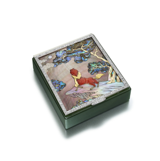 Vanity case composed of jadeite, the front adorned with a mosaic scene of carved coral, textured gold, and mother-of-pearl, with a diamond frame and a diamond-set thumbpiece; interior fitted with a mirror, powder compartment, and a detachable lipstick holder
