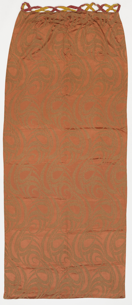 Curtain of heavy orange silk with an allover flowing foliage design in an Art Moderne style. Lined and interlined with velvet loops attached.