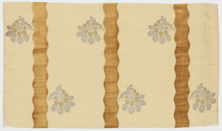 Length of solid light tan grosgrain has broad vertical wavy tan velvet stripes and staggered floral sprays in gold and silver metallic thread.