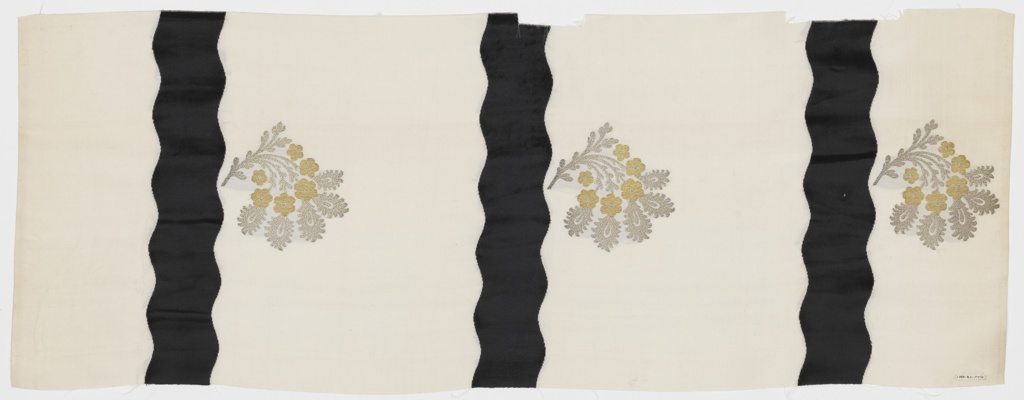 Length of solid off-white grosgrain has broad vertical wavy black velvet stripes and staggered floral sprays in gold and silver metallic thread.