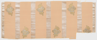 Length of solid light orange grosgrain has broad vertical white velvet stripes and staggered floral forms in gold and silver metallic thread.