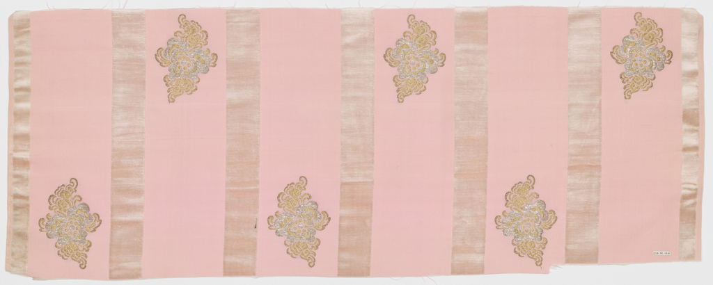 Length of solid pink grosgrain has broad vertical white velvet stripes and staggered floral forms in gold and silver metallic thread.