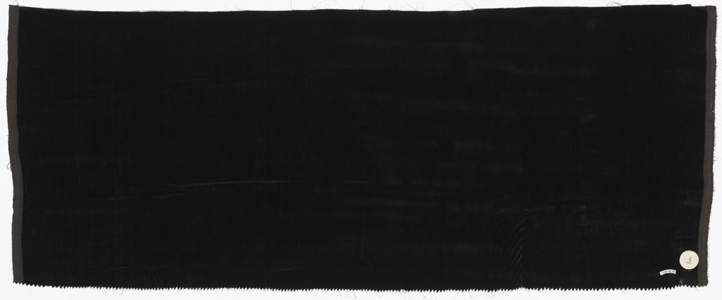 "Length of solid black cut ""transparent"" velvet."