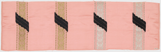 Sample of pink satin has vertical gold and silver stripes in a scroll pattern banded by dots. Stripes are crossed diagonally with small scalloped bands of black weft velvet.