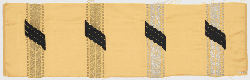 Sample of yellow satin has vertical gold and silver stripes in a scroll pattern banded by dots. Stripes are crossed diagonally with small scalloped bands of black weft velvet.