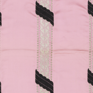 Sample of pink satin has vertical silver stripes in a scroll pattern banded by dots. Stripes are crossed diagonally with small scalloped bands of black weft velvet.