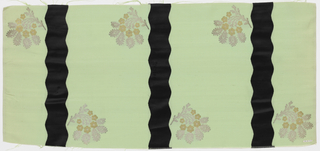Length of solid light green grosgrain has broad vertical wavy black velvet stripes and staggered floral sprays in gold and silver metallic thread.