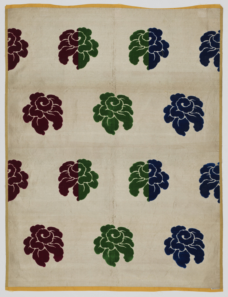 Staggered horizontal repeat of large scale stylized roses. Roses are in red, dark green and blue on a silver metallic ground.