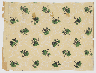 Lacey foliage diaper pattern in white, with insets of varnished green ivy leaves. Printed on light yellow ground. Three pieces.