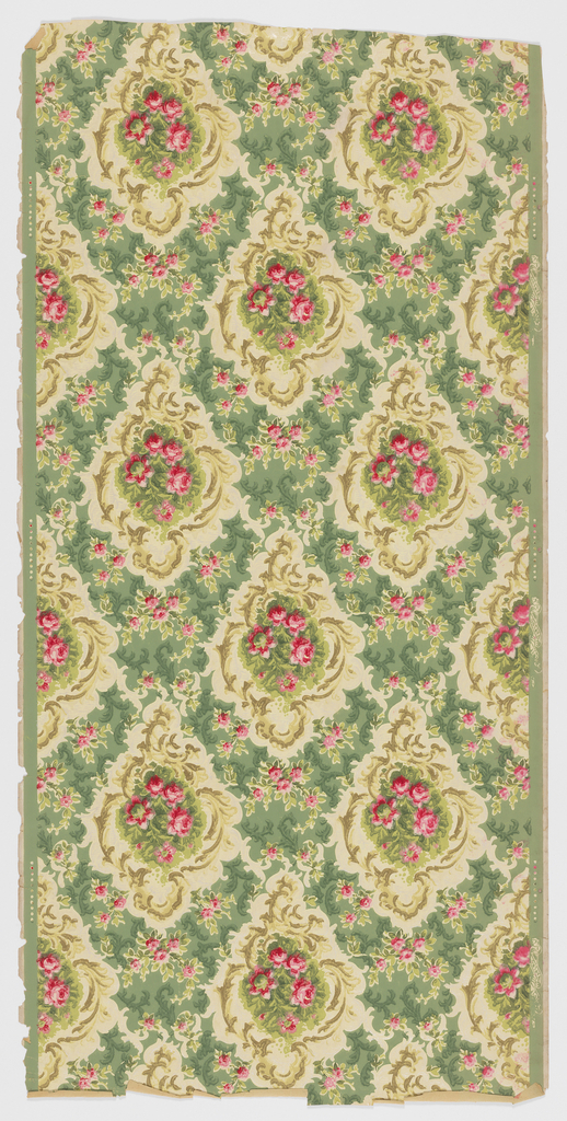 Very dense pattern, with floral medallions closely spaced, forming a trellis or diamond diaper design. Printed in red, green, tan and off-white on green ground.