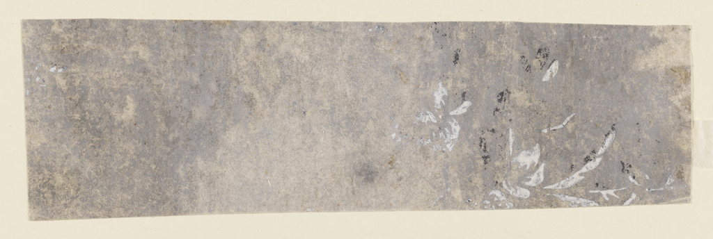 Against a light gray ground, faded and rubbed, is the faint indication of a design printed in black and white.