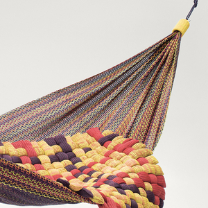 Multi-colored ropes with varying thickness intertwined to create a large sling