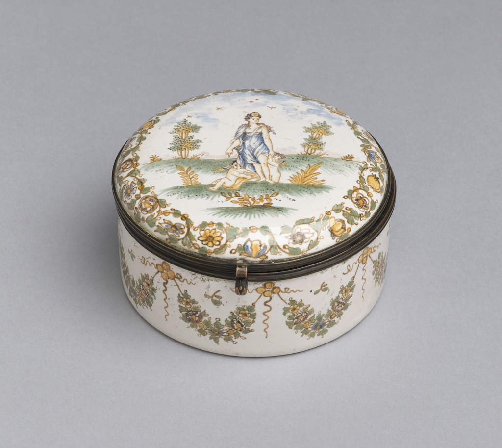 Short, cylindrical form with hinged, slightly domed circular lid; polychrome decoration on white ground, lid with scene of blue-robed maiden flanked by two putti; sides decorated with ochre and green flower garlands.