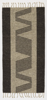 Double-faced flat woven rug in dark gray and tan. Two side borders flanking a field of the contrasting tone. The field pattern a rhythmic repeat of S and Z closely spaced diagonal bars of various numbers.