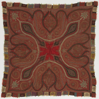 Square shawl with a small red center. Embroidered in a multicolored cone and flower design.