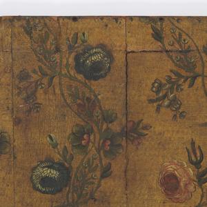 Vining floral pattern on textured ground.