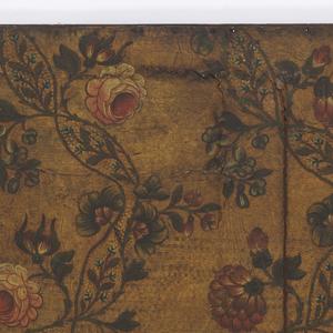 Vining floral design on textured ground.