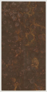 Oxidized flexible metal wallcovering, random circular pattern.