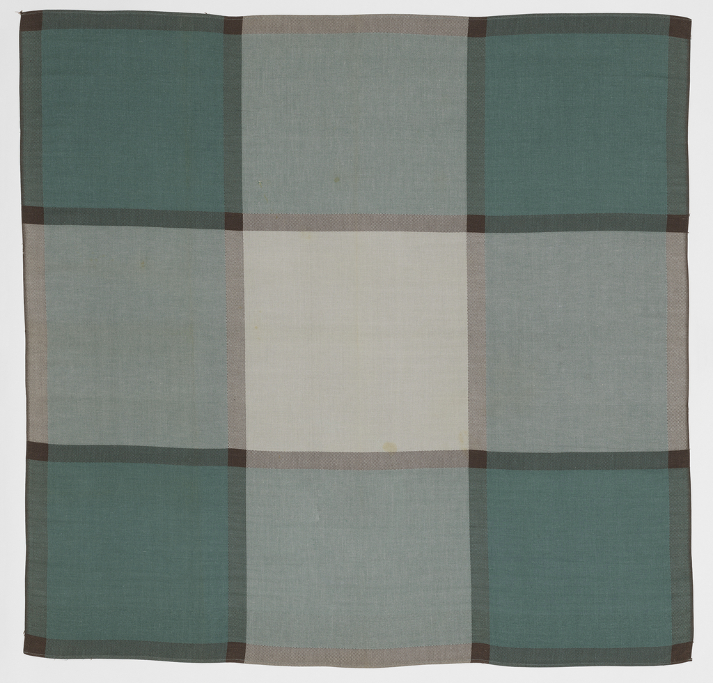 Square tablecloth with 2 hemmed edges and 2 selvedge edges. Large-scale windowpane check with large squares of gray and seafoam green, separated by narrow stripes of dark brown.