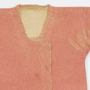 Short straight jacket with long straight set-in sleeves in pink silk lined with undyed glazed cotton and quilted in a fine allover zigzag pattern. Border of looser puffier zigzags on neck, front, hem, and sleeve edges.