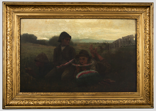 Horizontal view showing in foreground, three boys,( two african-american,one caucasion) eating slices cut from a watermelon that lies before them. On right  a broad wooden fence recedes into the meadow behind them and on left low tress and bushes fill the distance. A blue range of hills crosses the extreme background below a partially clouded sky.