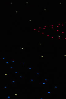 LED wallpaper with cube designs in red and blue on a printed circuitry pattern containing white LEDs on a green ground.
