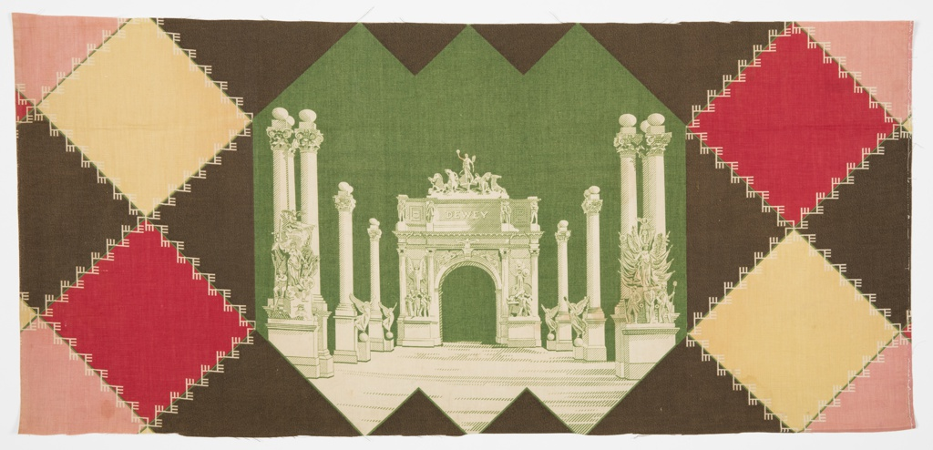 Commemorative textile with a depiction of the short-lived Dewey Arch and colonnade. Arch and colonnade are in white on a dark green ground. Diamond-shaped patchwork pattern in red, yellow, pink, and dark ground surround central arch motif. This textile was part of Hamilton's Zaza Quilting Line.