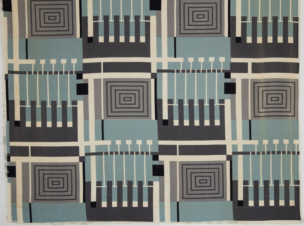 Length of printed textile with a geometric design consisting of concentric squares and fence-like vertical elements. In dark gray, gray, blue-green, black and white.