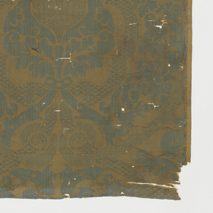 Interlacing ogives containing foliage and urns, Blue/green warp, yellow weft. Selvages at both sides.