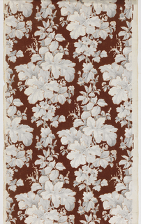 On flocked deep red ground, two identical columns of varying clusters of grisaille leaves and flowers - all finely outlined in light brown - drop repeat.