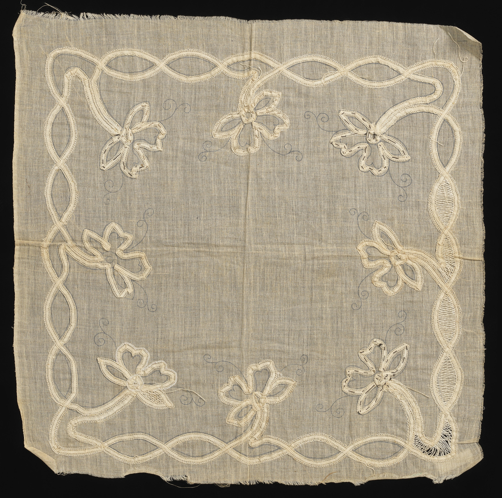 Pattern of flowers falling into the center of the handkerchief.