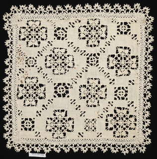 Square with bobbin lace edging has cross-shapes filled with needle lace fillings. These are inside a fine diamond lattice with small squares where lines intersect.