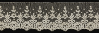 Joined flower and leaf motifs with dots; square mesh; scalloped edge;