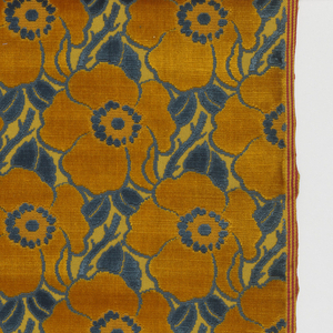 Conventionalized poppy blossom design in orange and blue on an orange ground.