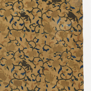 Tan ground with an allover design of a flowering vine in dark blue and light blue-green with flower heads and foliage in light brown with blue-green accents. A fantastic dog appears as part of the foliage in blue-green and dark brown.