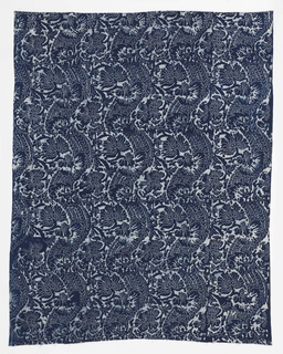 Length of indigo resist on cotton, made by the Kalamkari process (Kalam=pen; kar=work).  Pattern showing all-over serpentine bands with flowers.